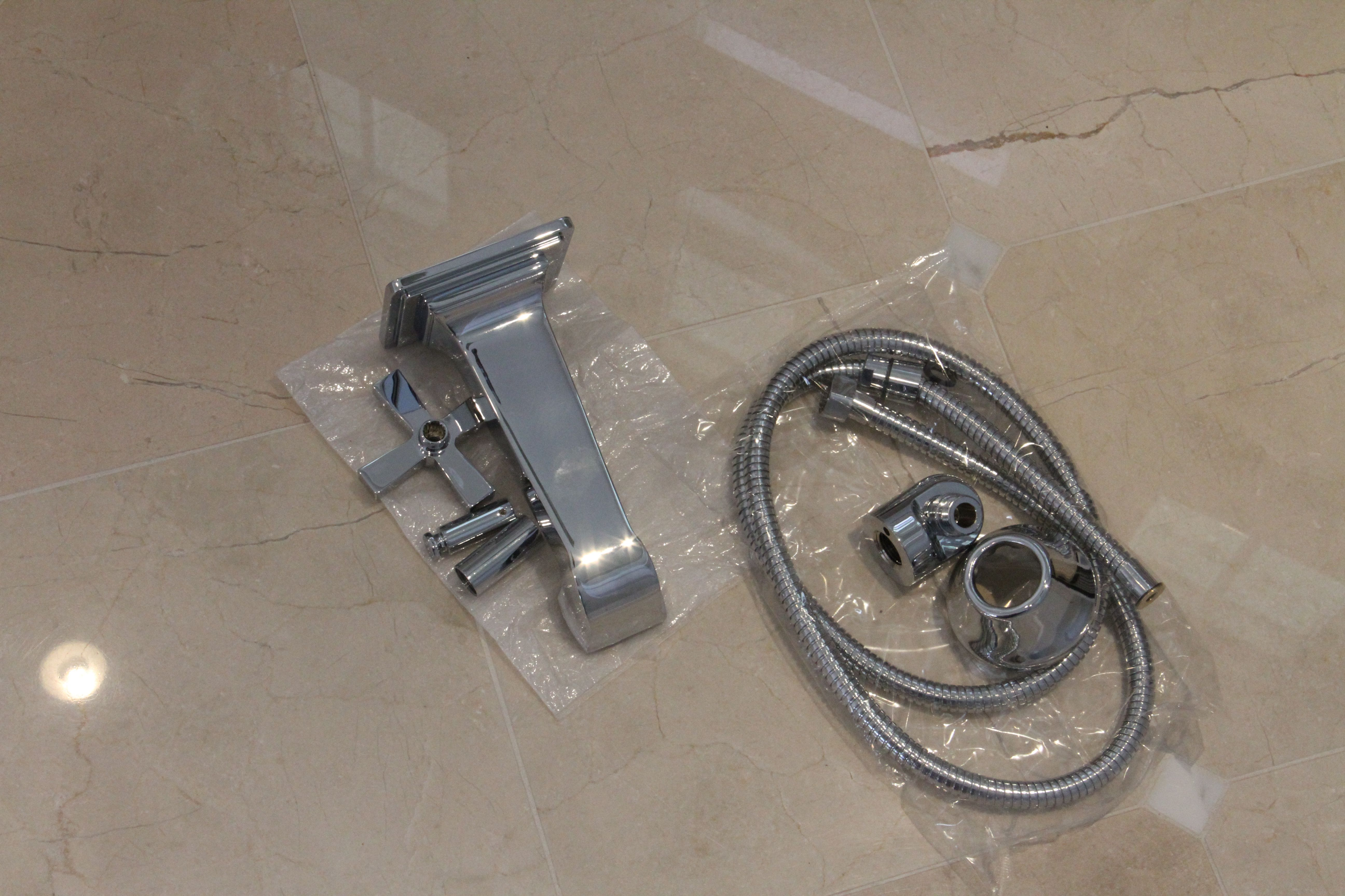 A peek at the tub faucet and body spray hose.