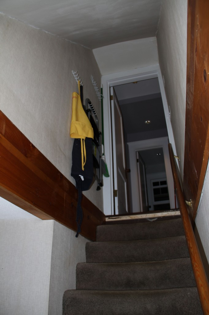 Ta-dah! A place for aprons, umbrellas, leashes (though sadly we don't need that anymore), brooms, dustpans, and stepladders.