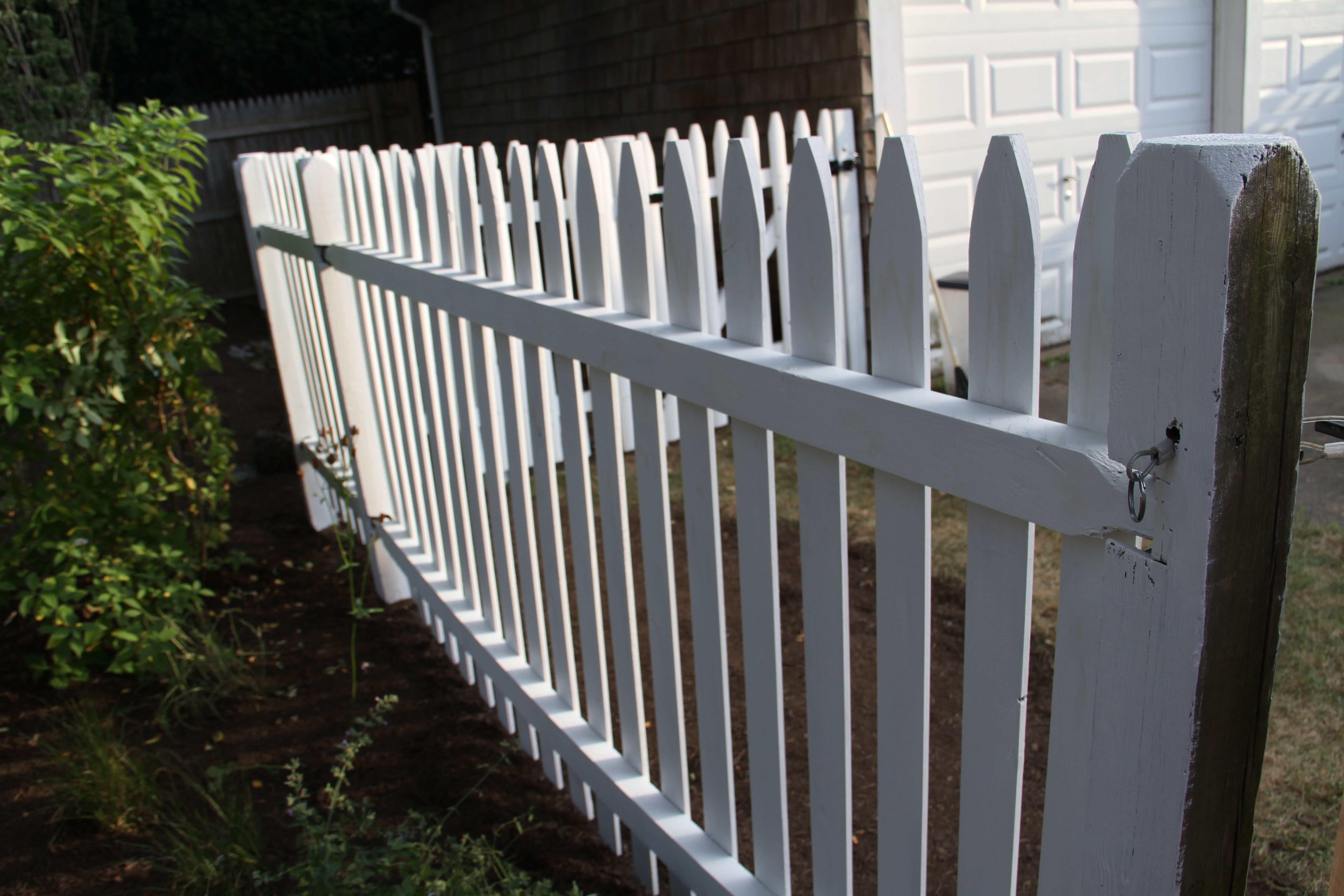 Classic white picket fence.
