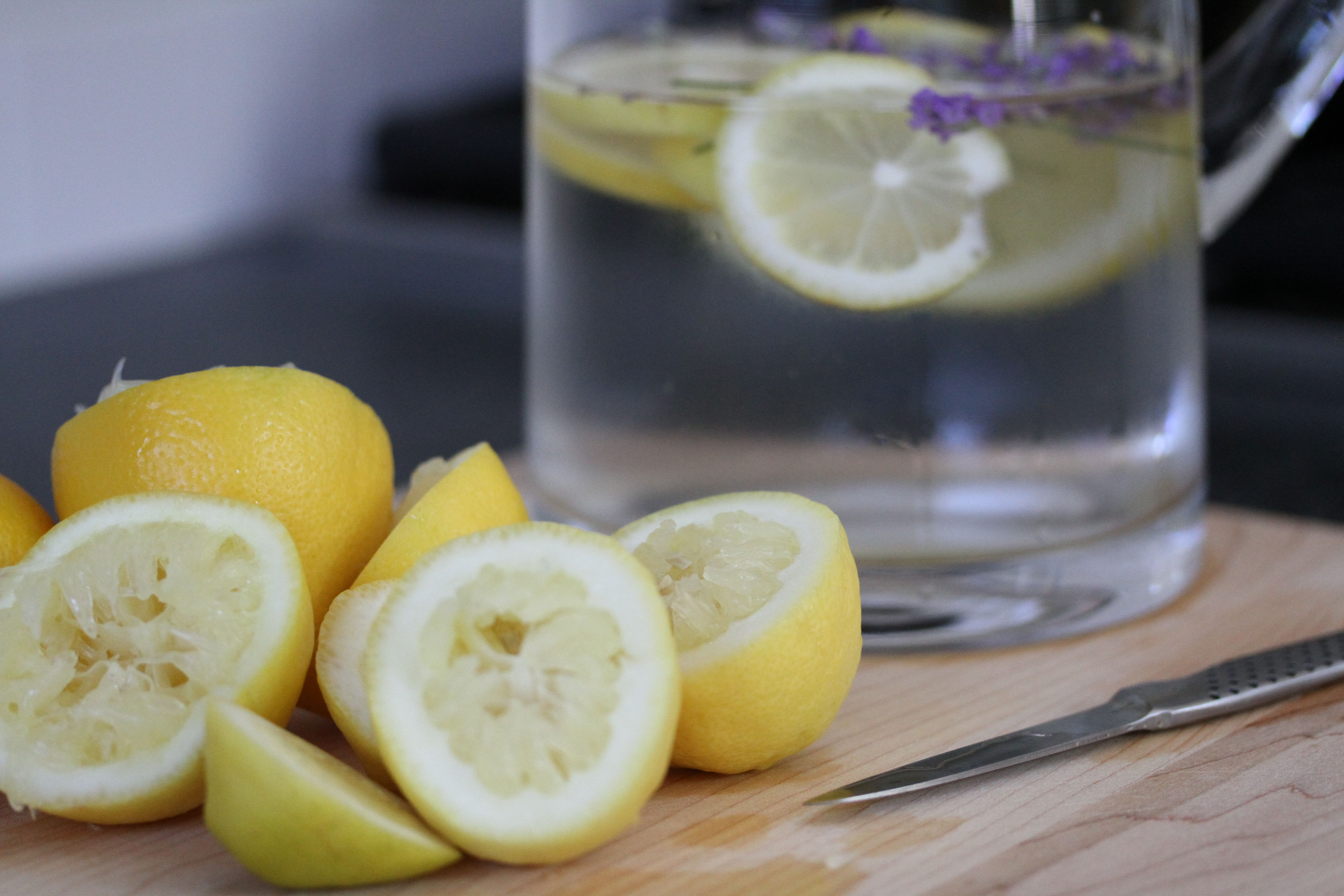 Toss the blossoms and slices into the water. You can see my lemons were not as juicy as I'd have liked.