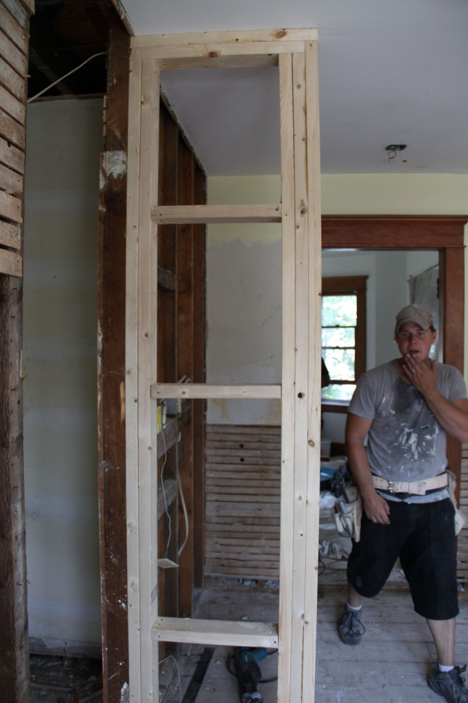 A new framed up wall to house some electrical, and to delineate the new location for where the refrigerator and pantry area will be.