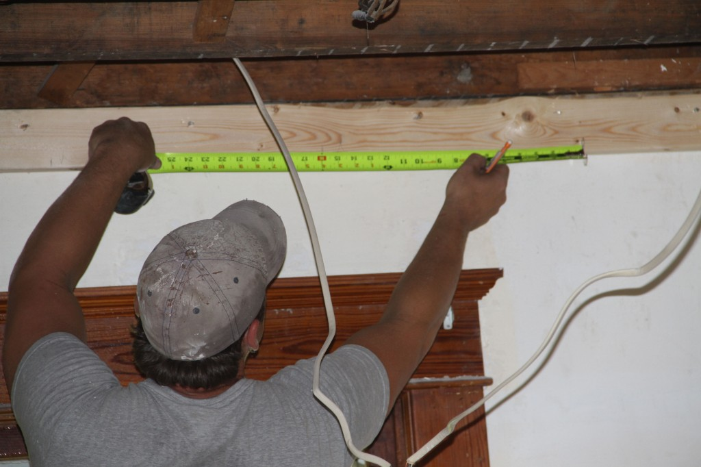 Brian measuring out the ceiling framing. These guys measure thrice, or maybe more to ensure the least waste possible.