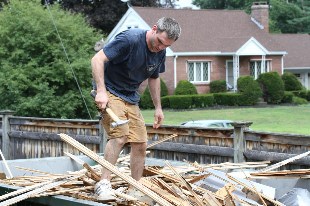 Jonas doing what you should NEVER do: walk on top of a pile of insecure lumber strewn with nails.