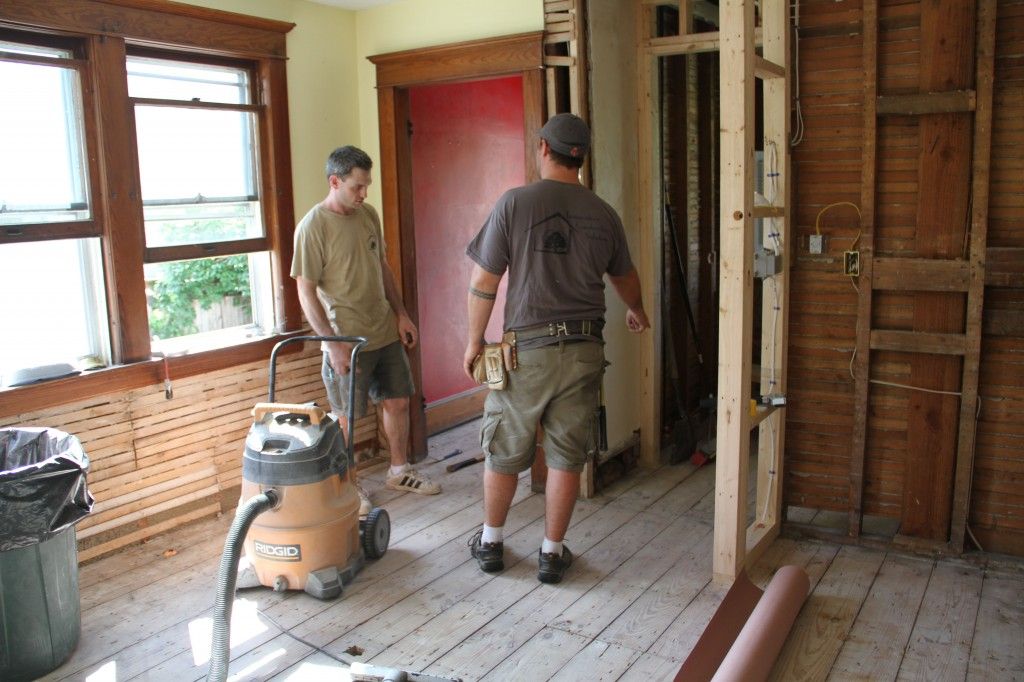Jonas and Dave working out the best place to begin installing the flooring.