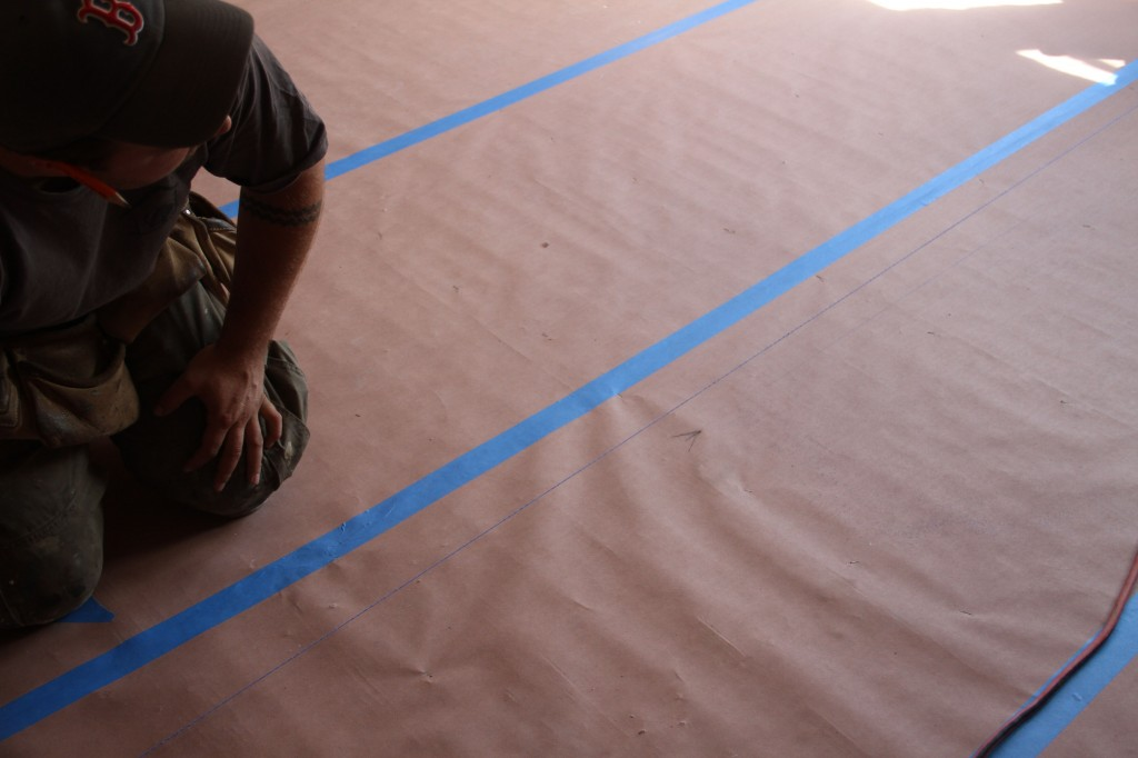 Snapping a chalk line.