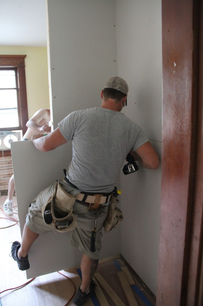 Sheetrock installation requires your entire body. Don't let anyone tell you different.