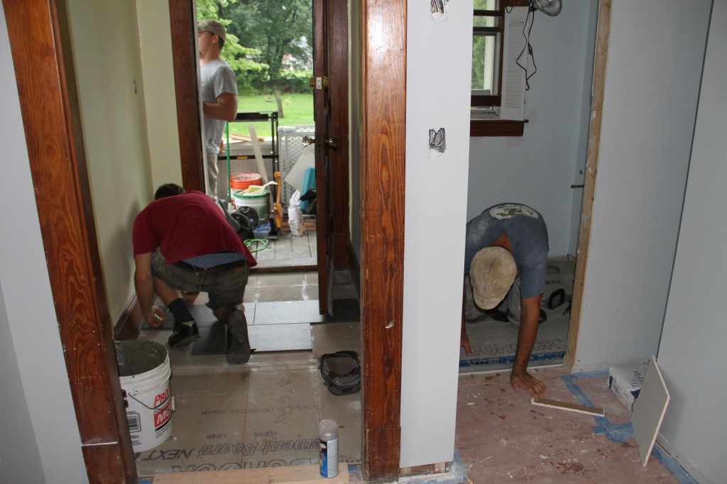 JJ and Caleb beginning to lay out their tile in the entryway and powder room.