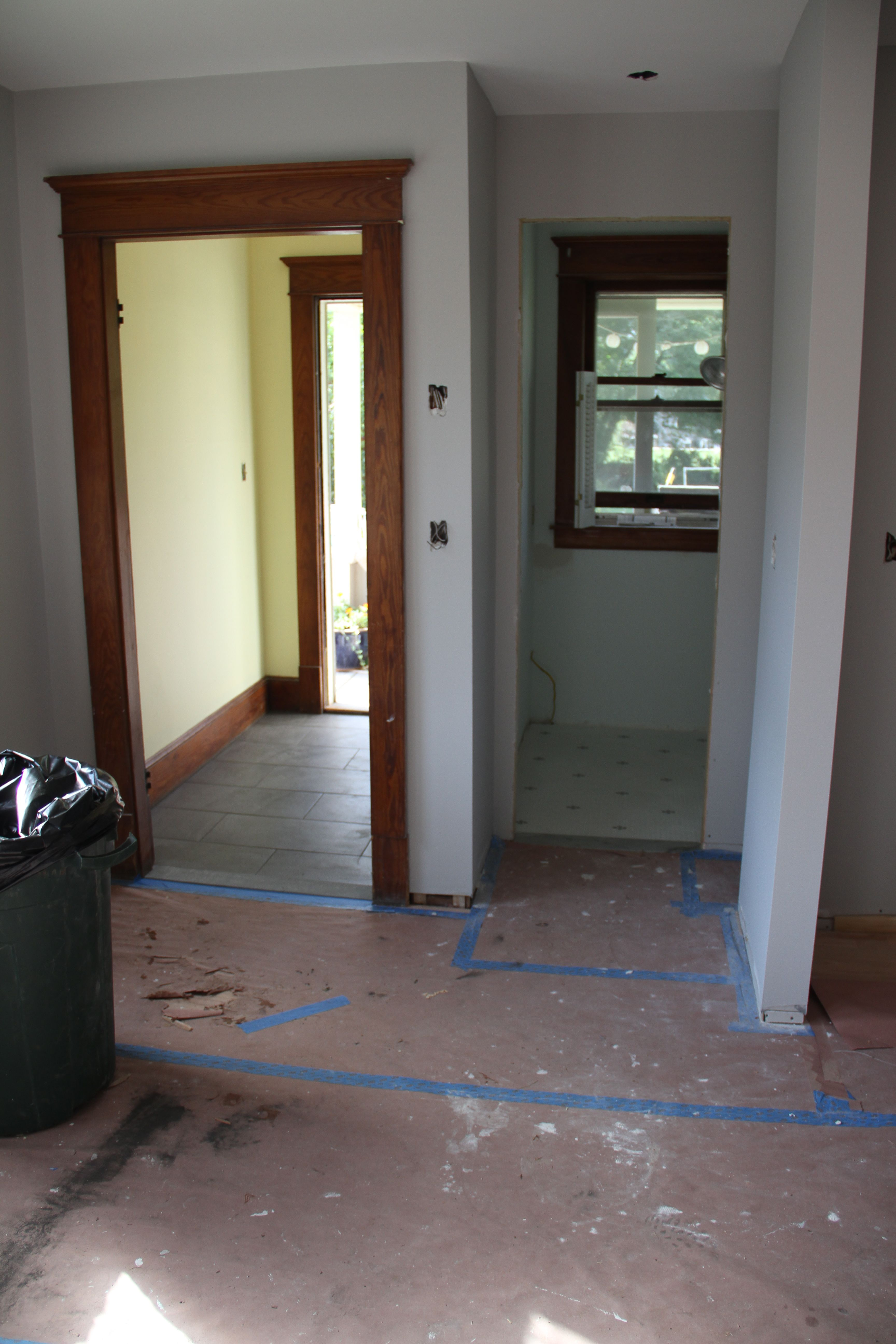 The two spaces, tiled and beautiful. A wee bit more painting and some floor protection and then it's on to wood flooring. Woo hoo!