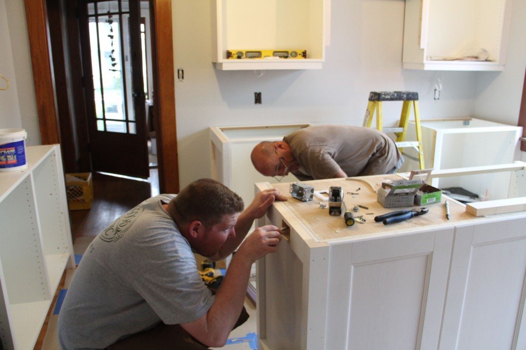 Brad installing a required outlet on the island. Pappy approved of Brad's skills. And that's saying something.