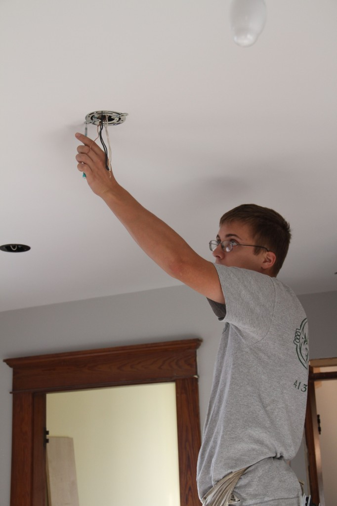 Eric working on installing the pendant fixtures.