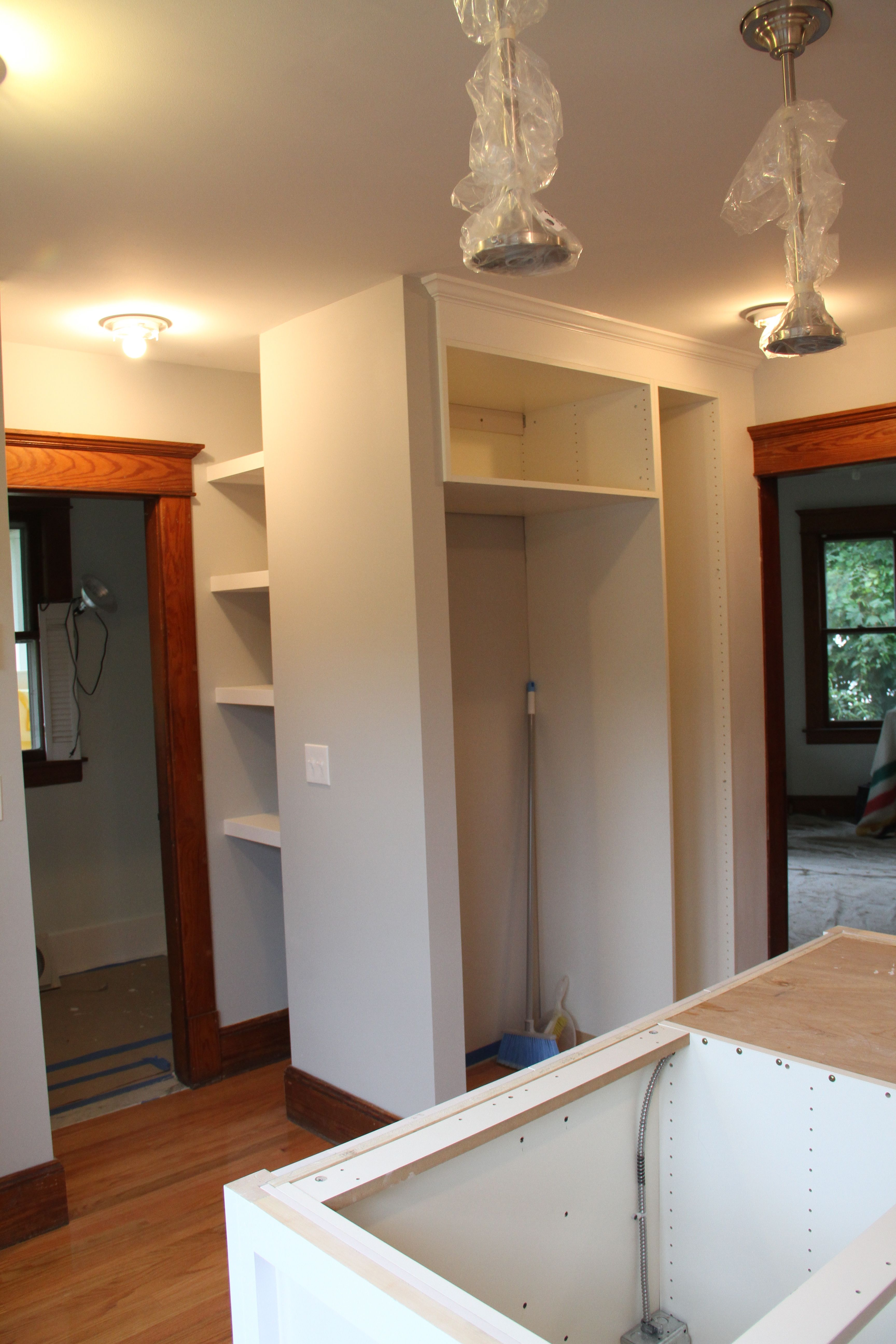 The pantry/fridge area awaiting plumbing (water supply) and the fridge which is already being used.