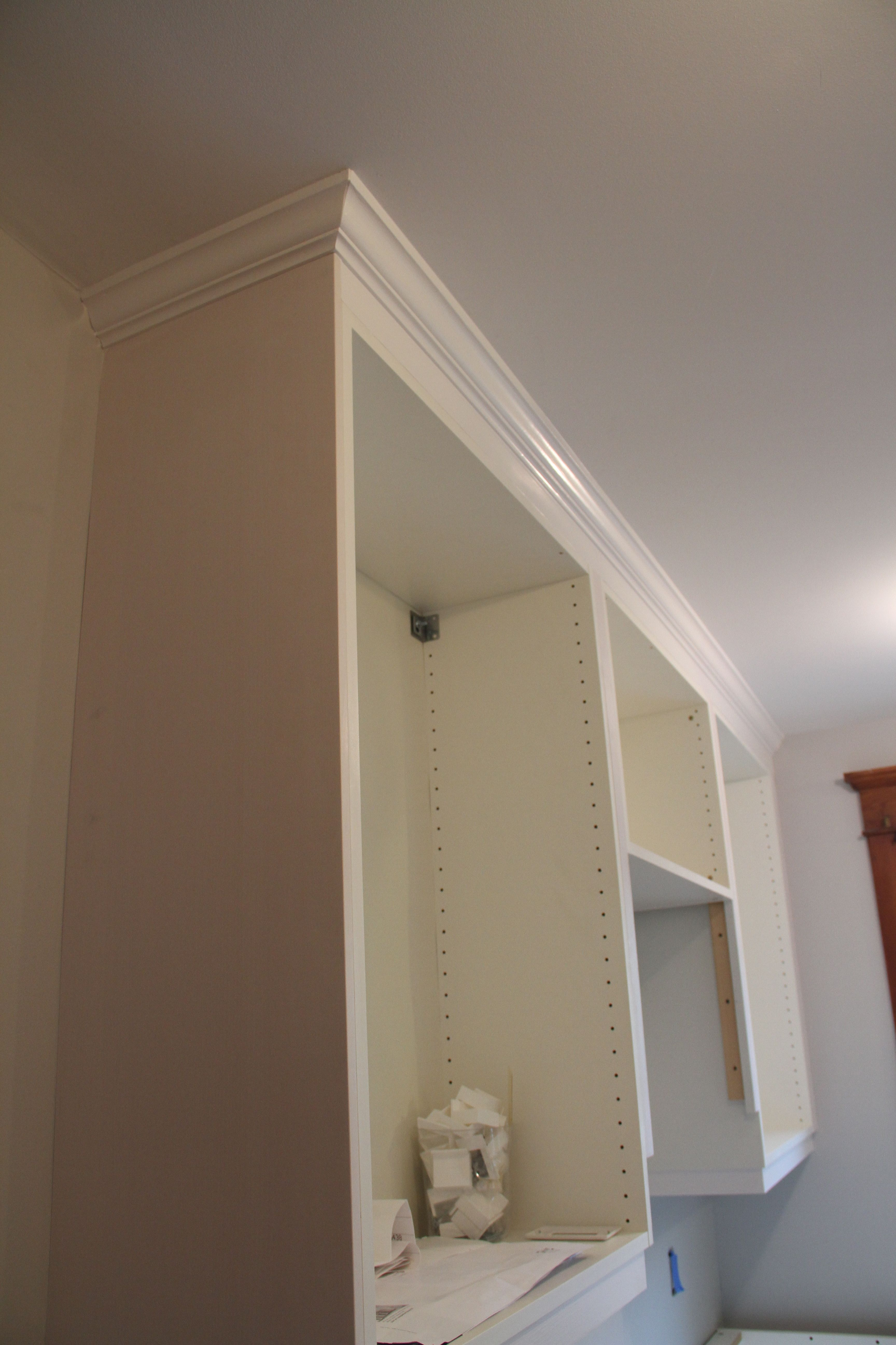 Crown molding (or moulding) really finishes the non-custom cabinets making them appear more expensive.