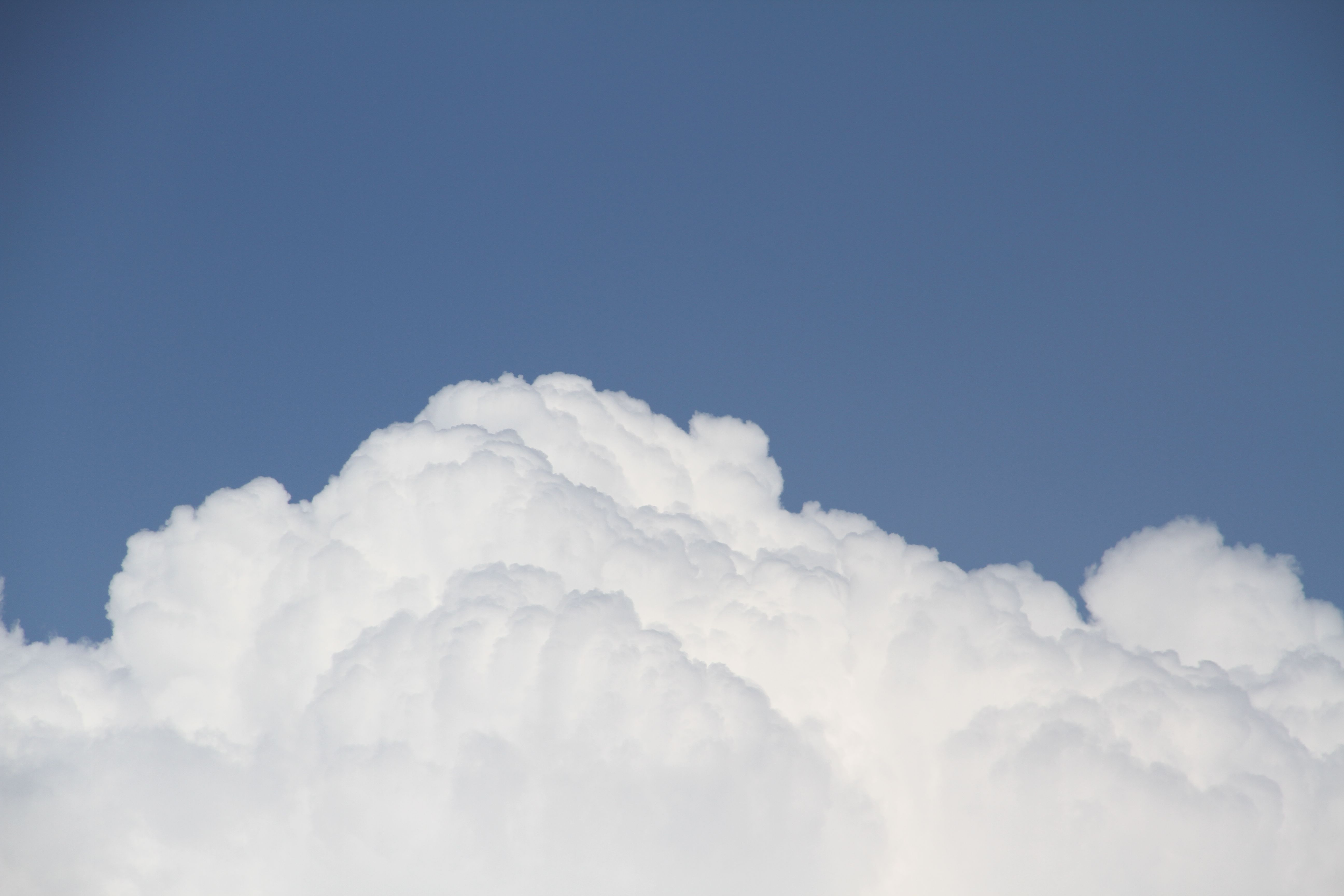 Beauty shot: And then I looked at these billowy clouds. Which was strange since it was raining on and off at the time.