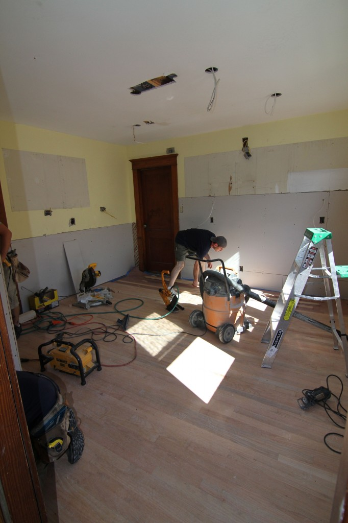 Jonas starting to finish up the last dregs of flooring. Sometimes the last 10% can be the hardest part of the whole job.