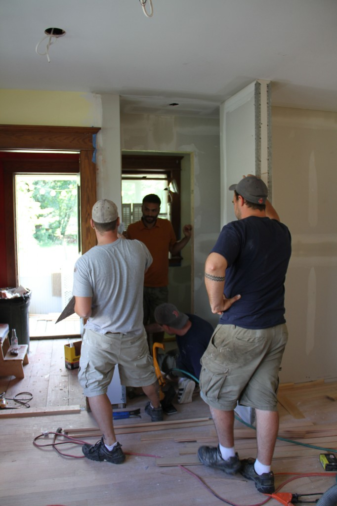 How many guys can we squeeze into a tiny space? There's Caleb inspecting the space for his tile requirements.