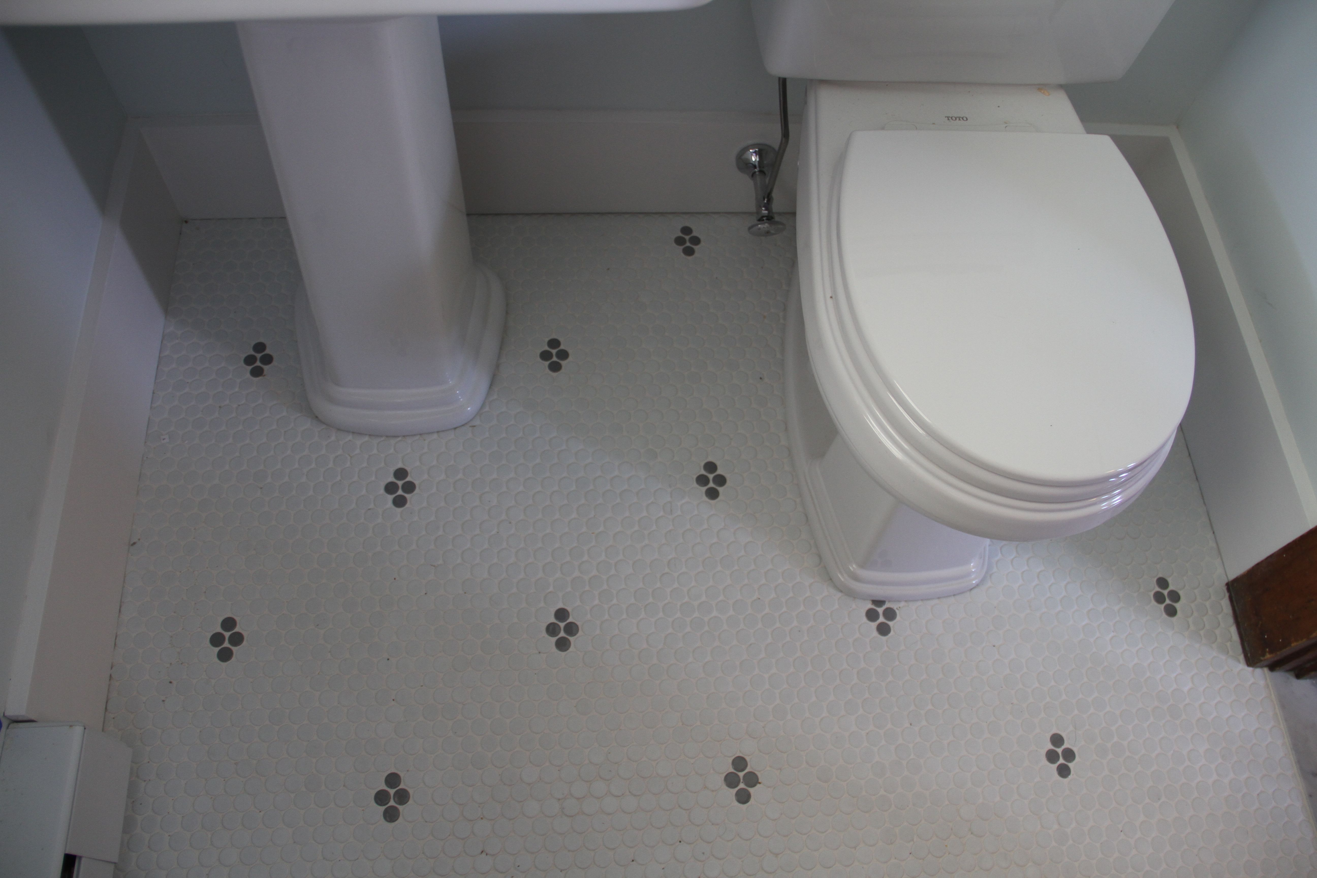 Sweet little floor in the powder room. Penny rounds are just too cute.