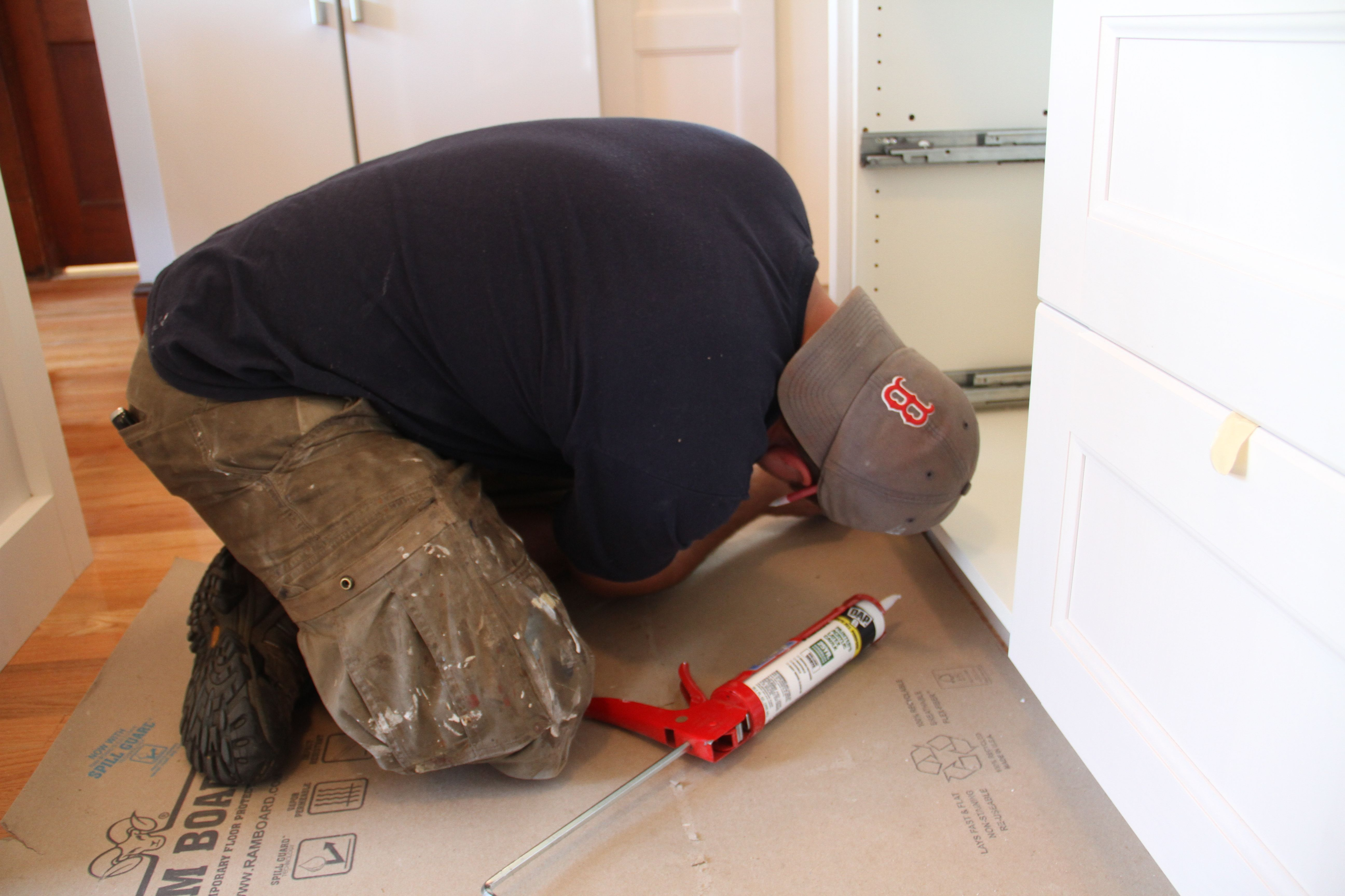 Dave contorted himself for the love of caulking.