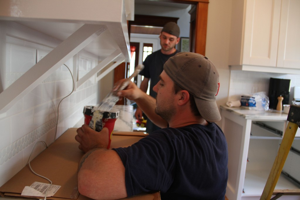 Dave and Jonas working away to finish up the minor details that make the kitchen go from in-progress to done!