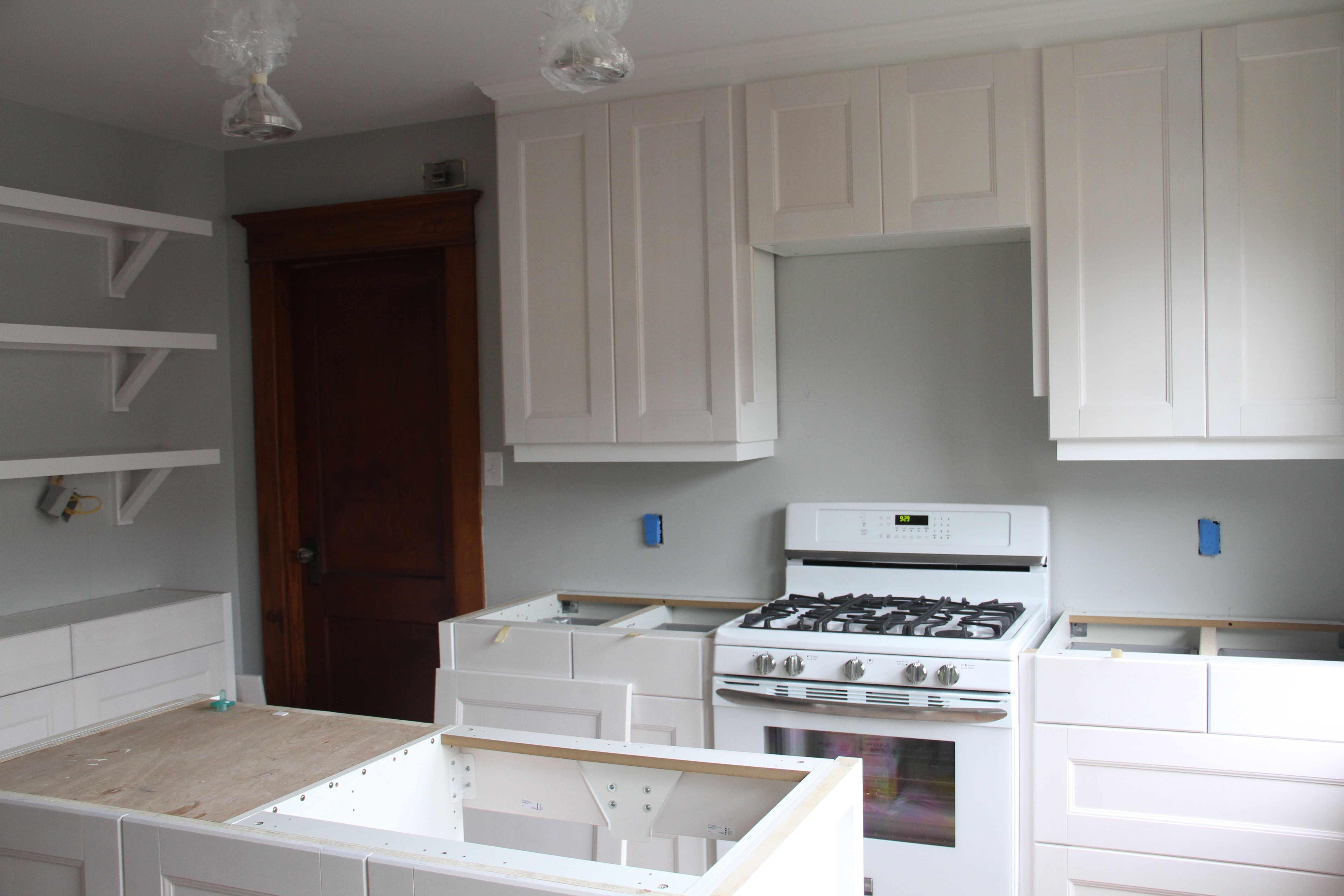 Mr and Mrs K were busy putting on door and drawer fronts, and receiving their lovely new stove! Quite the upgrade!