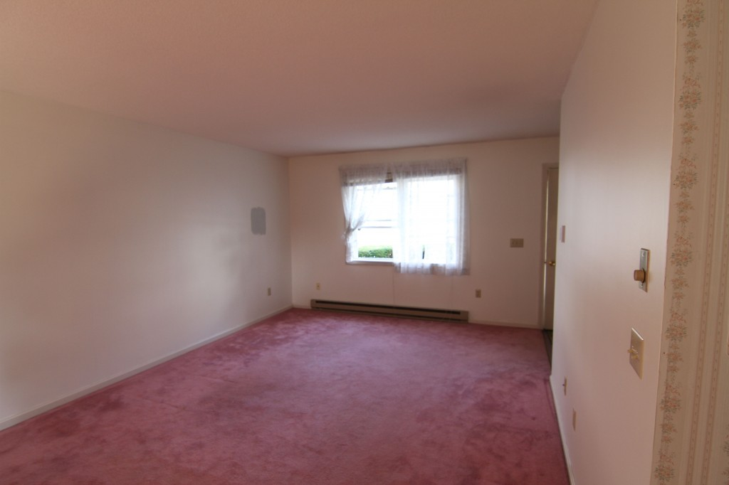 Living room BEFORE: I know that pink was the hot decor item in the late 1980s, but, yeah, no. No, no, no.