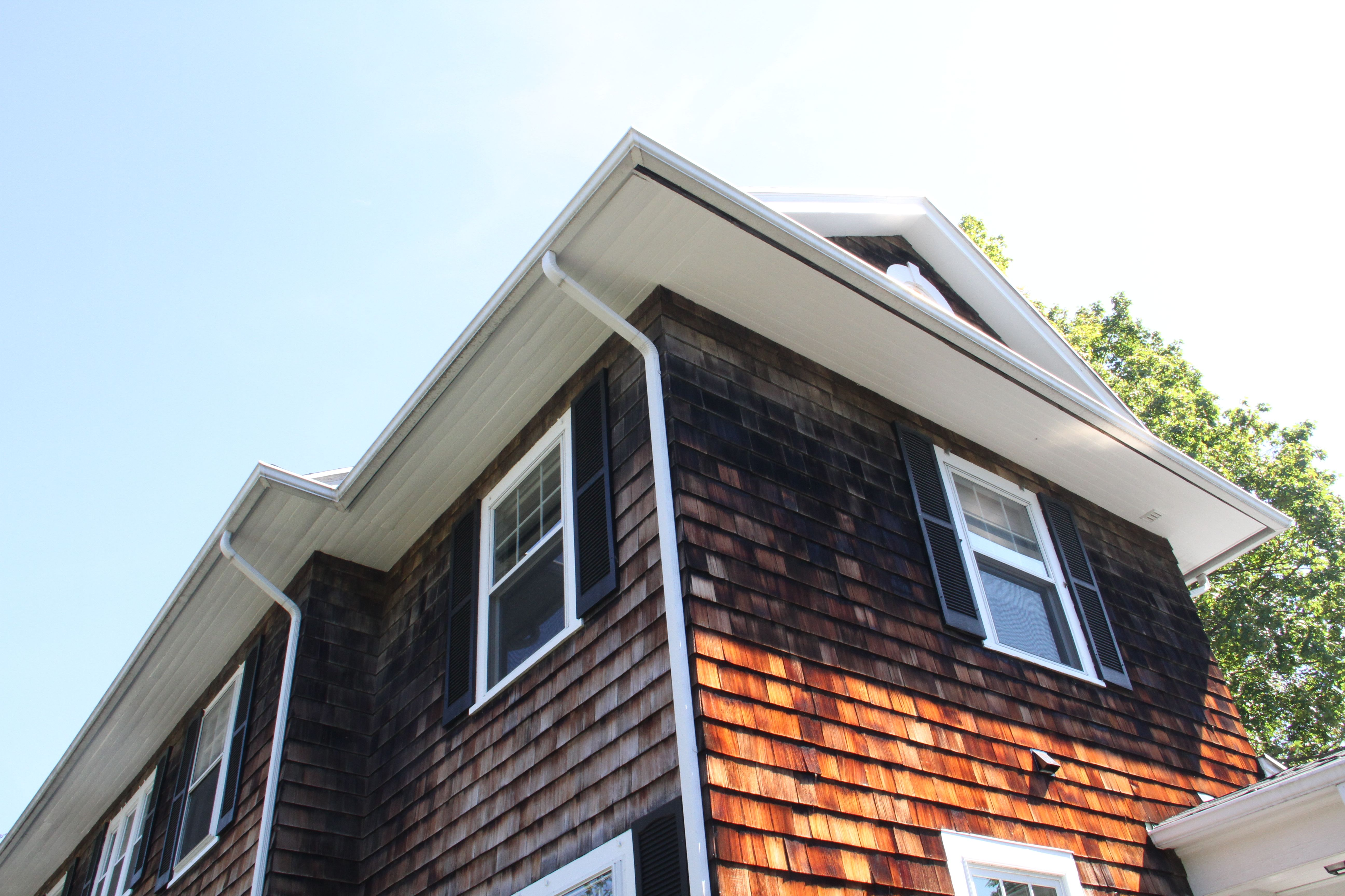 When I left this eave had been halfway scraped and primed. When I got back it was done.