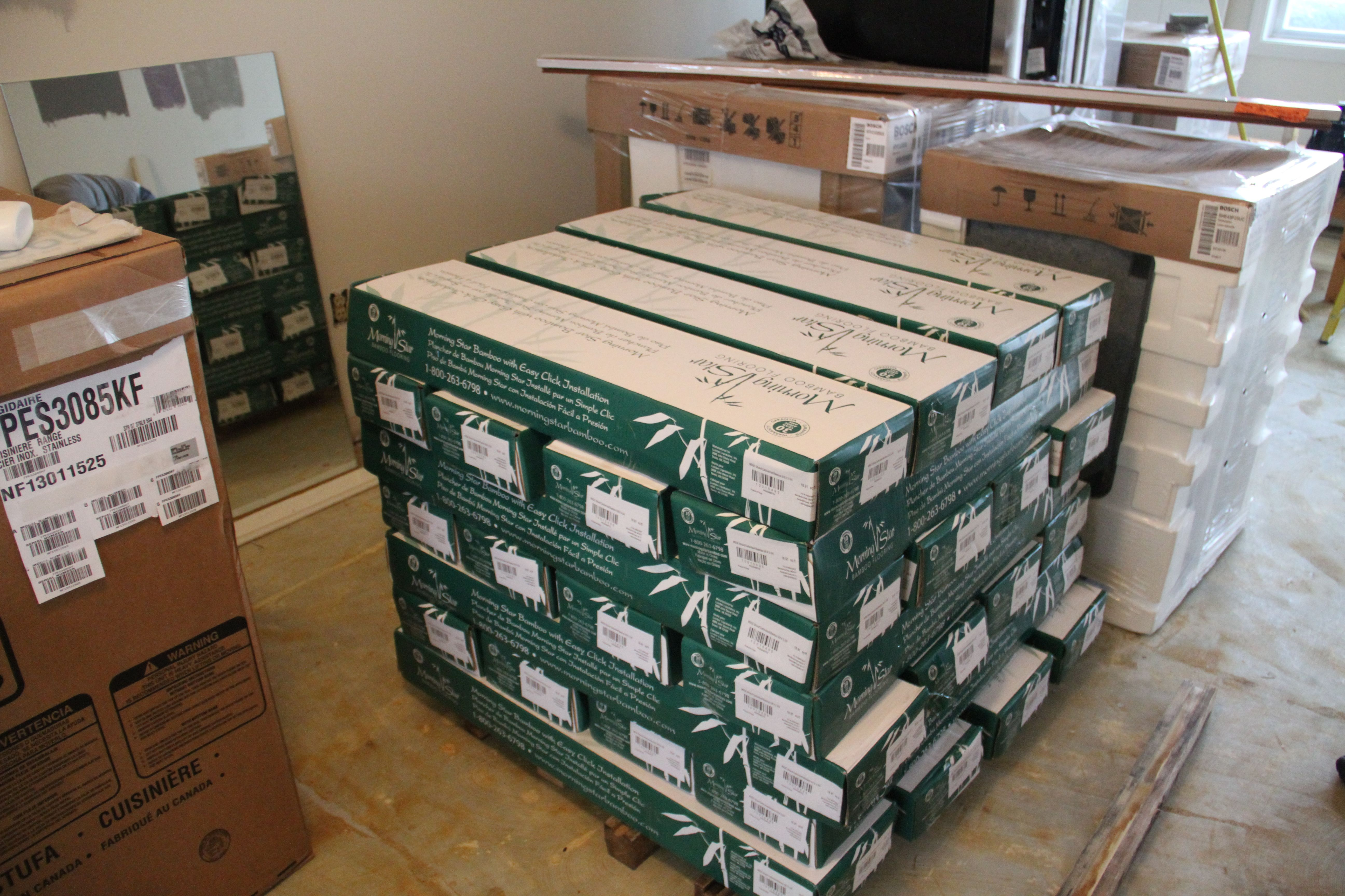This is half of the flooring, stacked so that air can circulate and the floor can get used to the climate in the condo.
