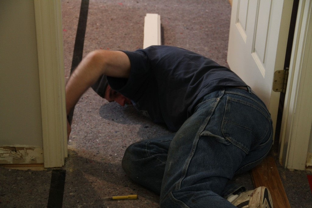 Jonas went ahead of Dave and Brian to remove the part of the door jamb that was previously buried in the carpeting.