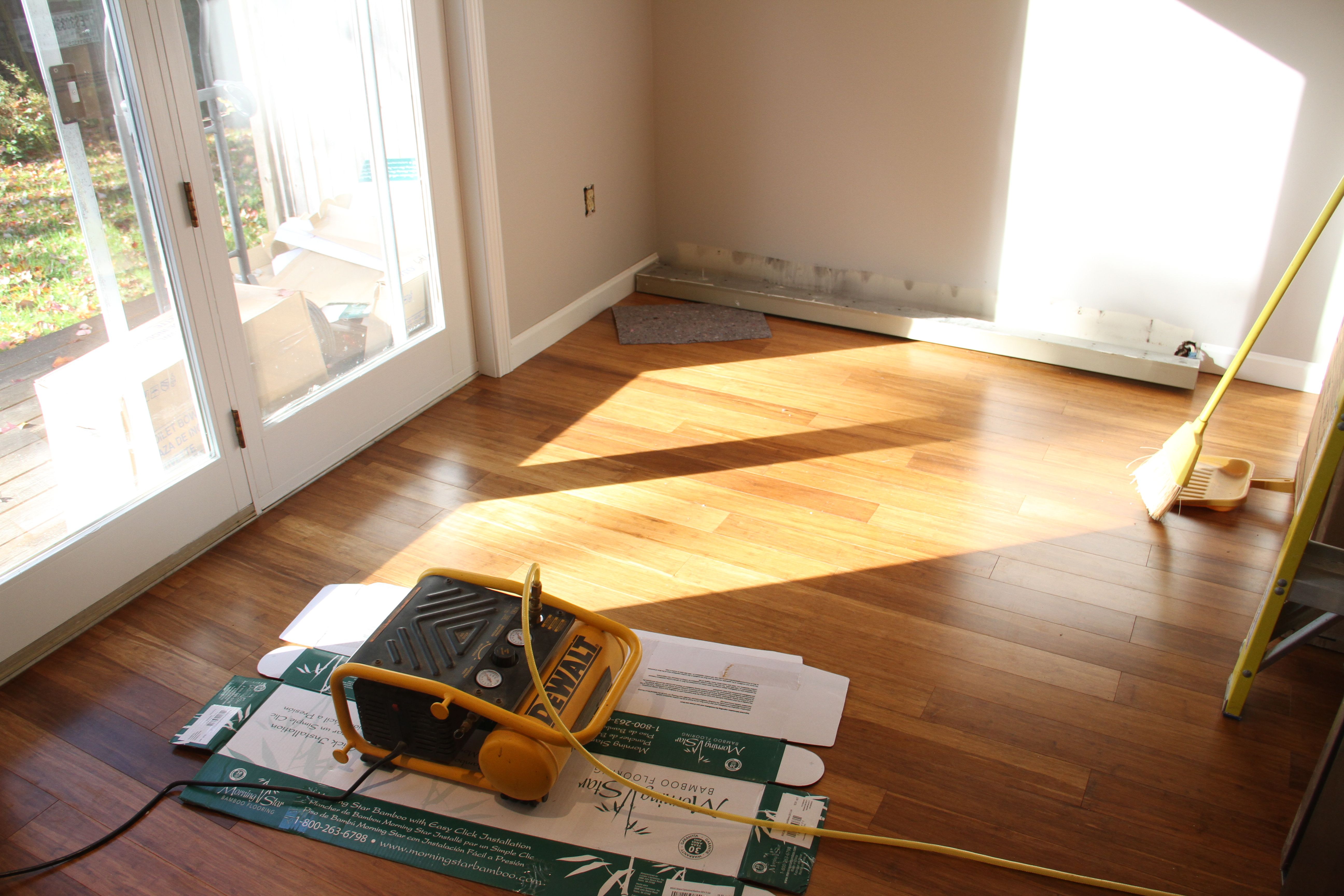 Meanwhile, Jonas had been installing baseboard all over the house. And then the sun came out. It gave me my first glimpse into the gloriousness that is now my mom's house.