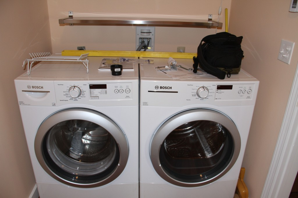 AFTER: Laundry facilities, no leaks, no COINS! My mom has used coin-op for, I don't know, ever? Now, she has the luxury of doing her wash whenever she likes, sans roll of quarters.