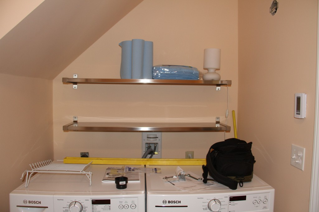 AFTER: Laundry shelves. We knew we needed something here, and we'd been dying to try the IKEA stainless steel shelves. Grand!