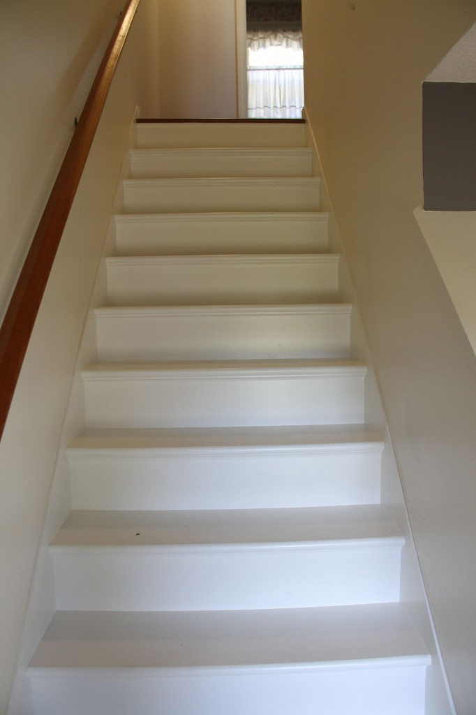 AFTER: These stairs were basically builder's stairs - stained, paint slopped on them, pitted, dented, nail and screw-holed - only ever intended to be covered in carpeting. Paint, patience and some love and attention were all they needed to get shined up again.