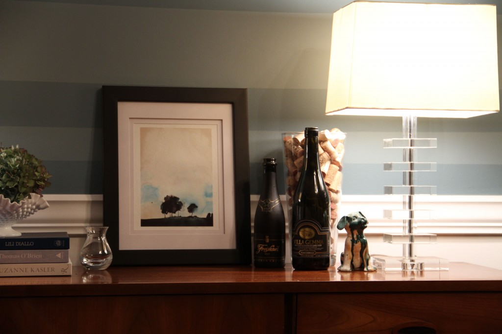 I pulled items from all around the house. That cute little painting was in my office, but the color works so well with the walls that I didn't mind parting with it.