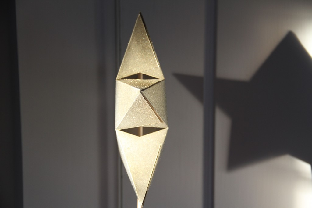 Side view of the star. I made this out of card stock, which I also later sprayed with gold, silver and glitter spray paint. It's a 2-sided, 3 dimensional piece held together by glue stick, patience and luck.