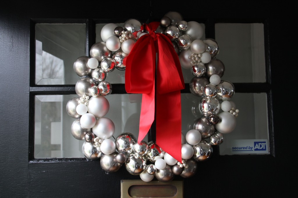 The wreath of ornaments on the front door. We lost a few (shattered) due to poor storage containters (none) and had to deconstruct then reconstruct the wreath. I'm glad it survived. I still love it. (This year I added that red bow left over from a former wreath from another year.)