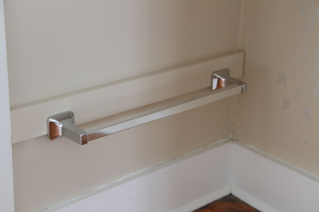 """AFTER: The silver towel bars are for hanging the laundry baskets from. We needed something that would be about 3-1/2"""" total and the towel bar plus the wood was exactly right. Score!"""