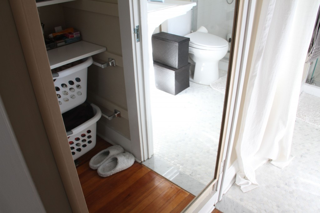 AFTER: I even have a little space beneath the laundry baskets for my slippers and our scale.