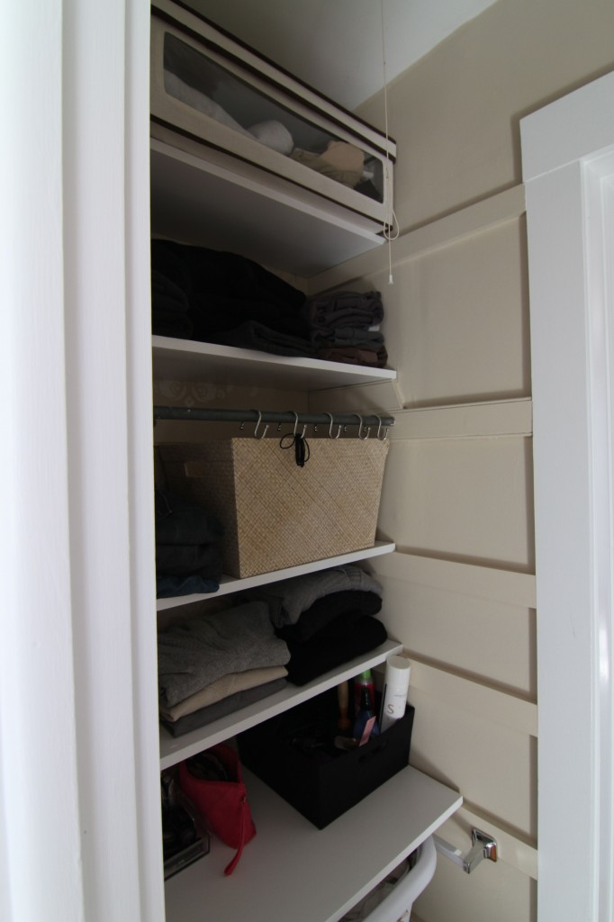 AFTER: The original skirt boards and the new ones seem to blend well enough, but since none of the shelves are affixed this closet can go back to hanging storage as the need arises.