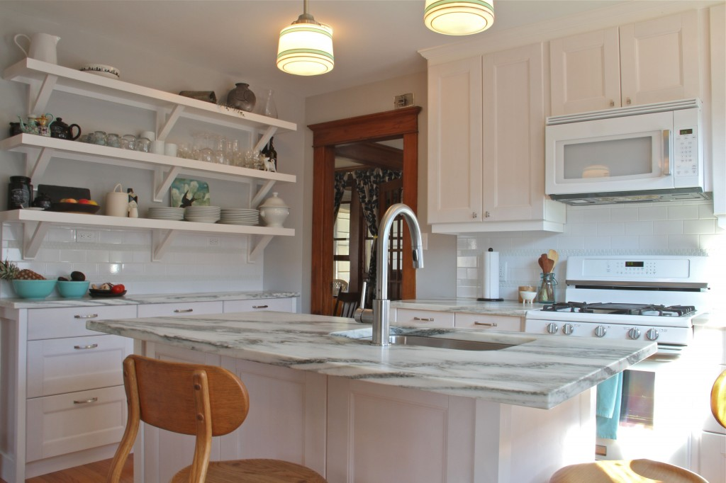 AFTER: Gone are the awkward cabinets, and cut-outs, and in their place are clean, simple shapes that are welcoming and efficient.