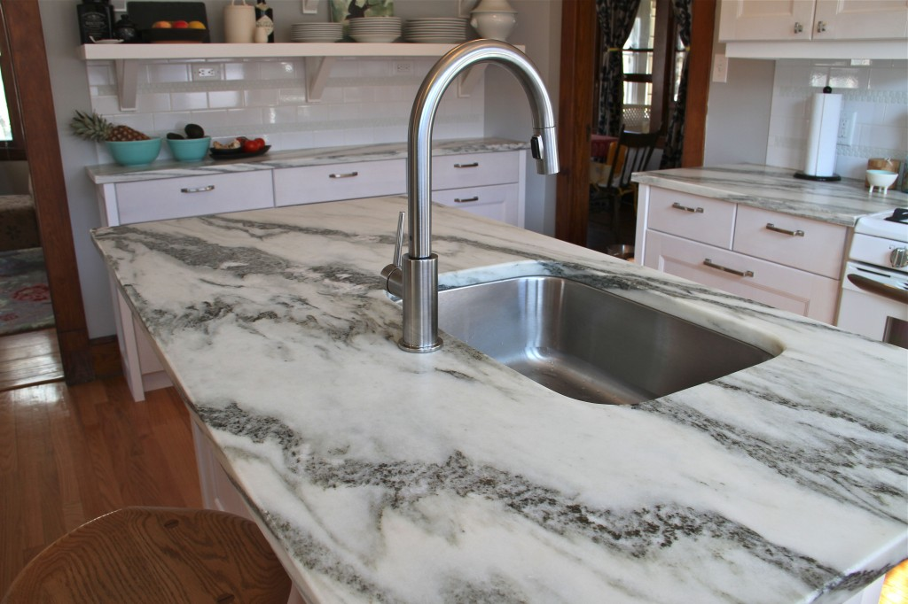 AFTER: While the kitchen isn't huge (approx 12'x12'), the island is still the hub of the space, housing the sink, dishwasher, seating and a lovely piece of Vermont Danby stone (which is a locally quarried marble from, you guessed right, Danby, VT).