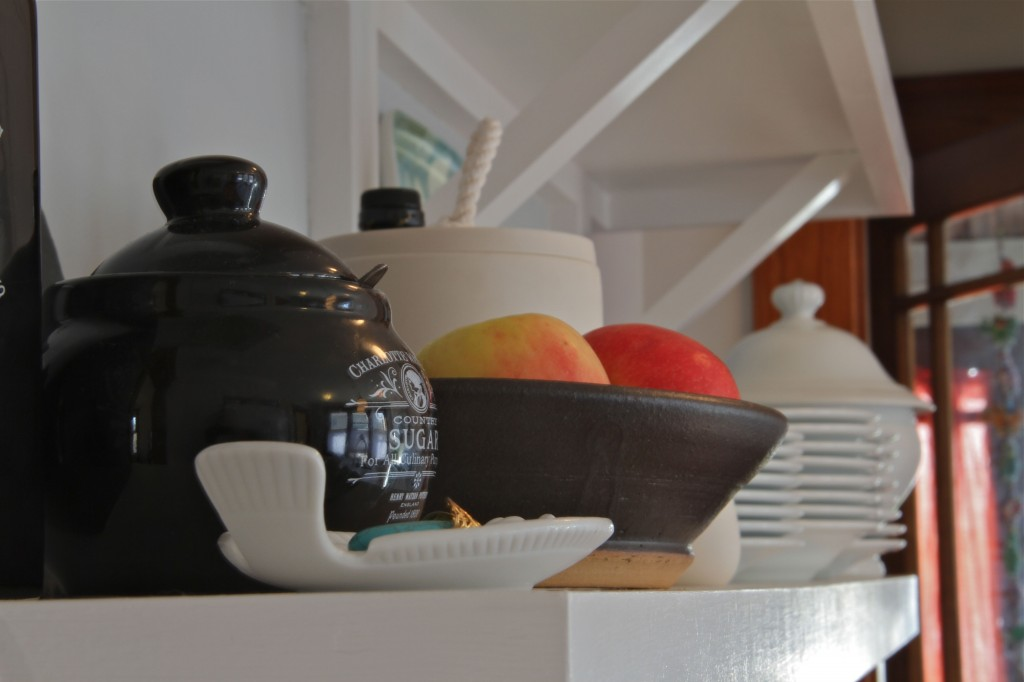 AFTER: Beauty shot - open shelves with lovely display of keepsakes and useful day-to-day kitchenware.
