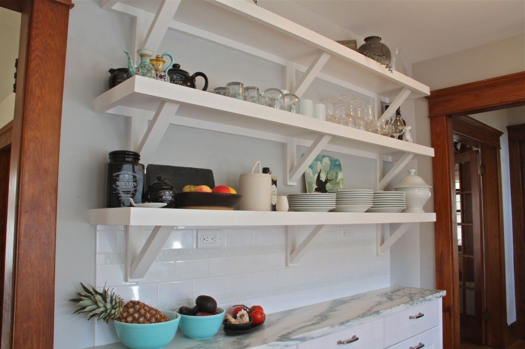 AFTER: The shelves AND the lower cabinets are about a foot deep, giving ample counterspace for a buffet, and ample upper-reach storage, while keeping the aisle open and easy to move through.