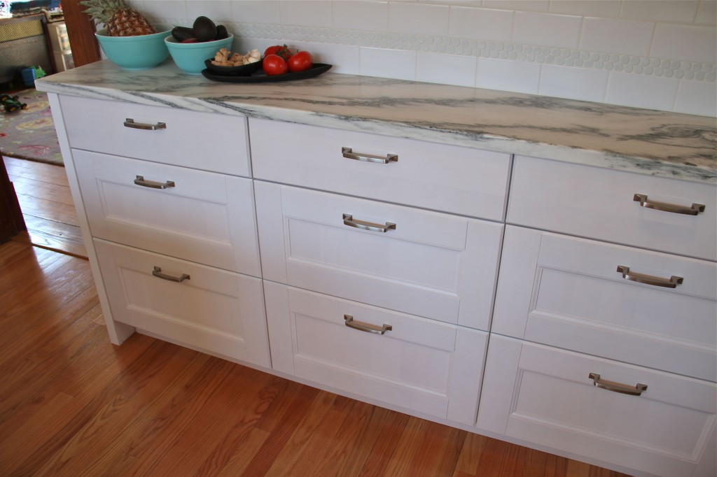 AFTER: Mr and Mrs K were able to find shallow depth lower cabinets in completely non-custom IKEA cabinetry (which was dressed up a bit by Team Carpentry).