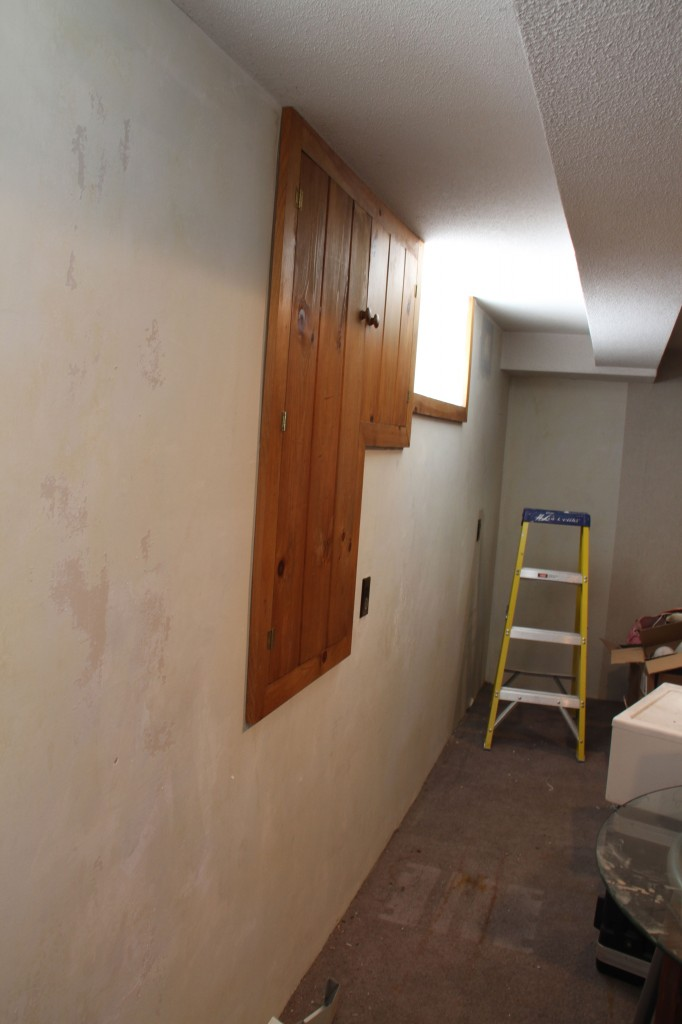 The walls are not smooth like brand new drywall. The wallpaper had been put directly onto unprimed sheetrock making the glue virtually impossible to remove with a chemical.