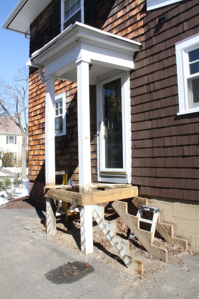 DURING: Our plan is to redo the railings to match the other side of the house, use cedar to wrap all the pressure treated (i.e., ugly) lumber, and to replace the storm door that pretty much failed after our kitchen renovation.