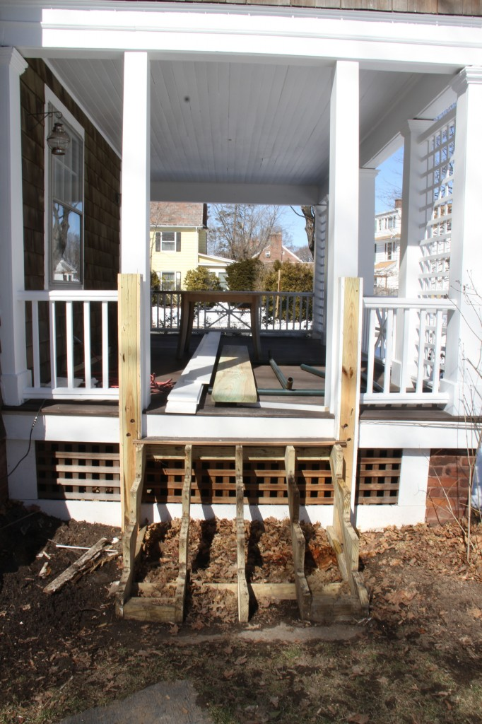 DURING/before: so, this porch we paid to have redone when we bought the house in 2006/7. The stairs were wrapped in pine (bad idea!) and were already rotting. Enter Team Carpentry.