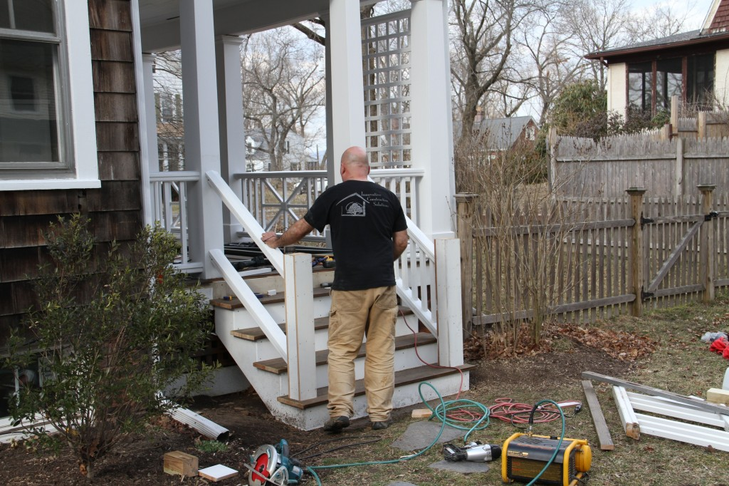 DURING: Pappy working on the railings for the main porch. The look here is one of restoration, and I believe they nailed it. (Puns are free around here.)