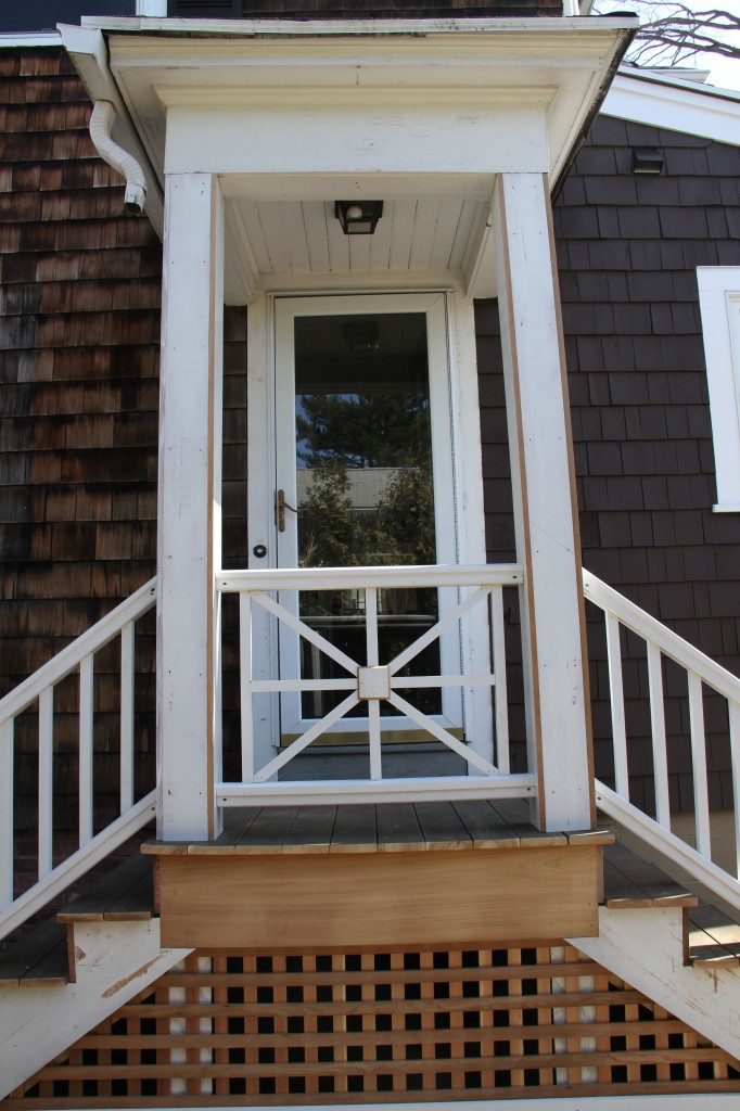 AFTER: We still have the business of a new storm door to install (the one pictured above didn't really survive the remodel and is terribly hard to open and close), but the overall look of the entry gives instant curb appeal.