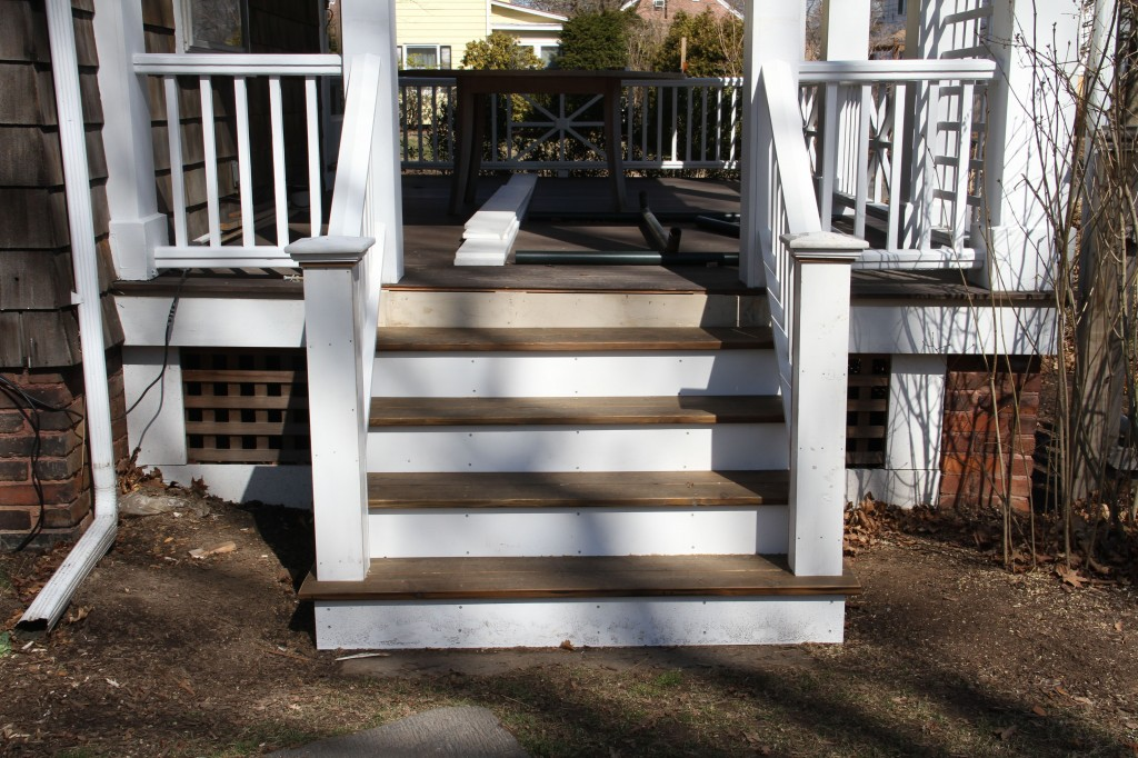 AFTER: The other porch stairs, in their full sunlit glory. Once it gets truly warm enough to finish painting, staining, etc., I'll take some new pictures, hopefully with lilac blooms to boot!