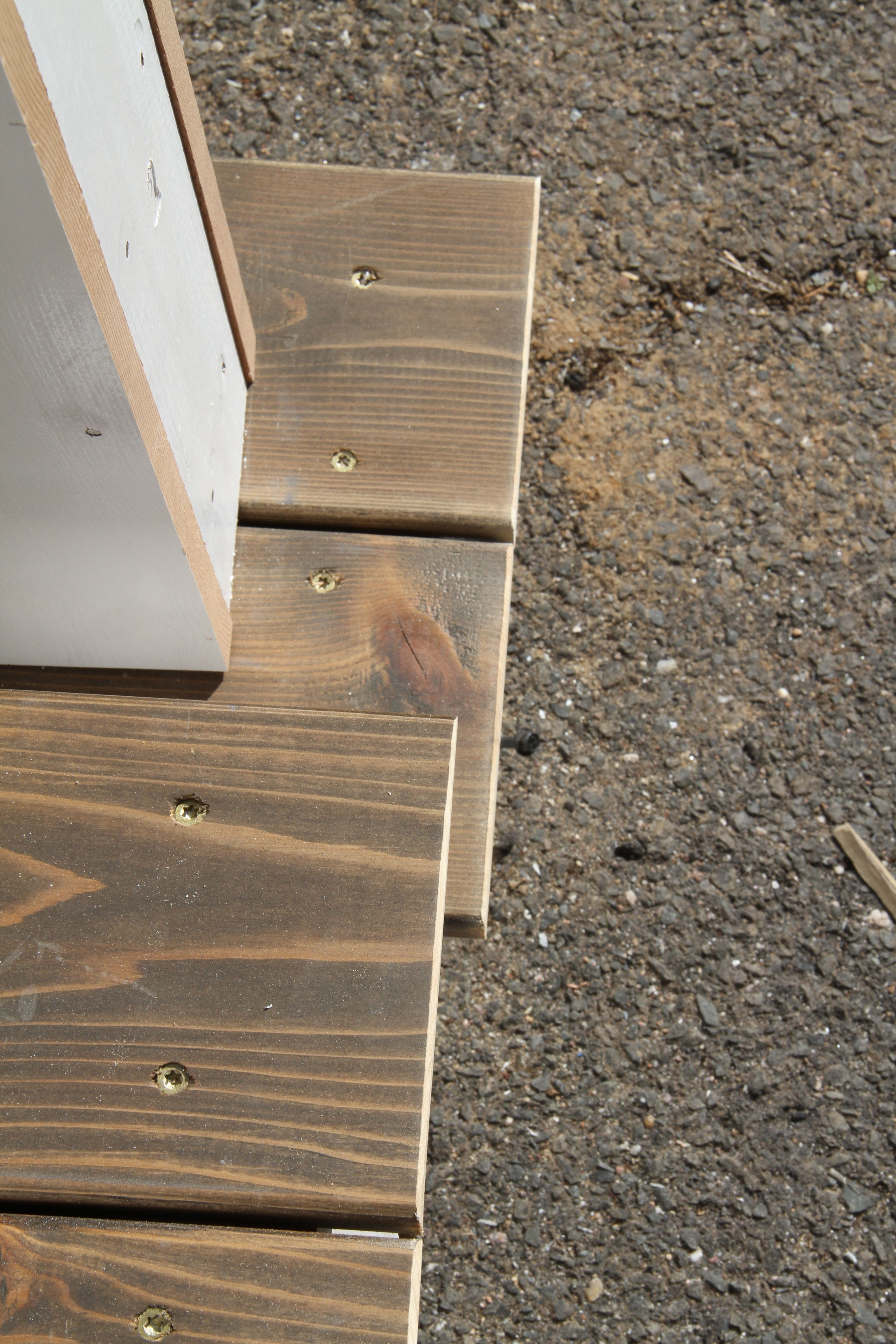 Jonas chose golden decking screws which I would normally have complained about, but in fact worked very well with the stain and the cedar. Touche, my friend. Touche.