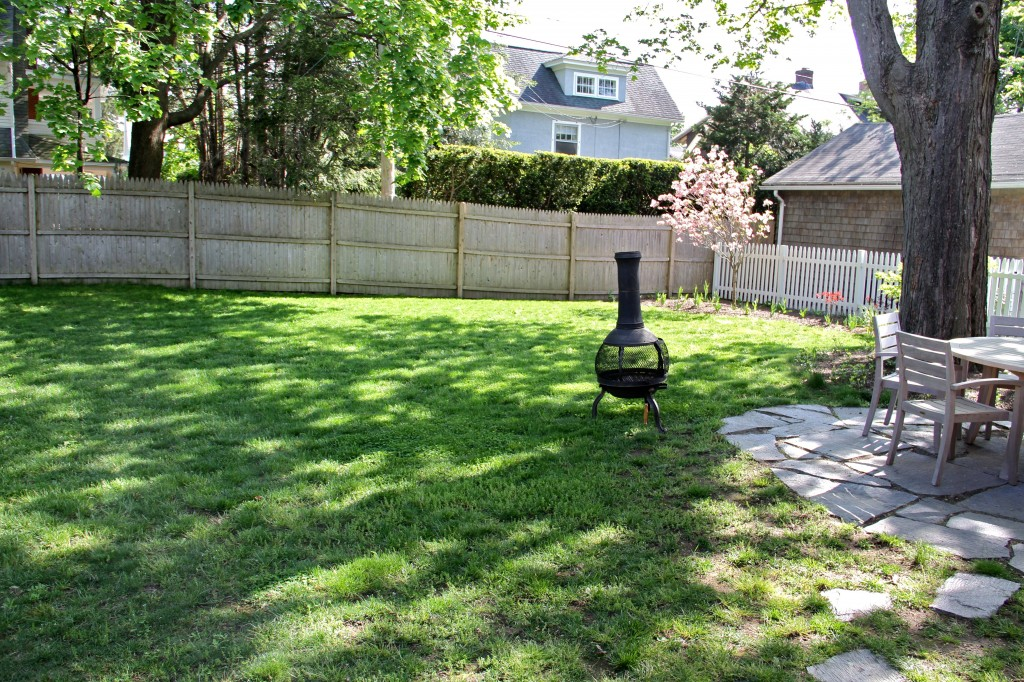 This is how the yard is looking these days - fence stained, compost contained, clean and pretty.